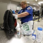 A TSA security officer checks a bag a day before the annual Thanksgiving Day holiday at the Salt Lake City international airport, in Salt Lake City, Utah, Nov. 21, 2012.