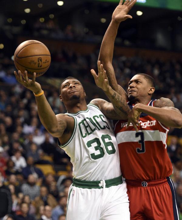 Boston's Marcus Smart (36) drives to the basket past Washington's Bradley Beal during Monday night's NBA game at TD Garden in Boston. The Celtics won 110-102.