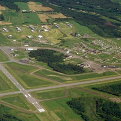 This archived aerial photo shows the Northern Maine Regional Airport and vicinity in Presque Isle. The airport received a $250,000 grant from the Northern Border Regional Commission in 2016 to  help construct a five unit, heated airport hangar for medical evacuation aircraft and business clients.