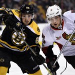Boston's Brad Marchand (left) and Ottawa's Bobby Ryan (9) battle for position during the second period of Tuesday night's NHL game at TD Garden in Boston.
