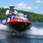Mark Haskell rides his personal watercraft on Lake St. George in Liberty in July 2005.