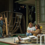 "Mill worker Ernie Donahue (James Herrera) works on his ark while his wife Marie (AJ Mooney, far right) and neighbor Nancy Letourneau (Jennifer Shepard) discuss the impact the strike is having on Abbott Falls in Penobscot Theatre Company's production of ""Papermaker."""