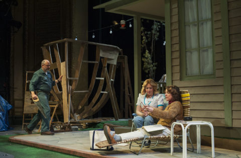 Mill worker Ernie Donahue (James Herrera) works on his ark while his wife Marie (AJ Mooney, far right) and neighbor Nancy Letourneau (Jennifer Shepard) discuss the impact the strike is having on Abbott Falls in Penobscot Theatre Company's production of &quotPapermaker.&quot
