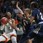 Miami's Jessica Thomas (3) passes the ball against Quinnipiac defenders in the second round of the NCAA women's basketball tournament on Monday, March 20, 2017 in Coral Gables, Florida.