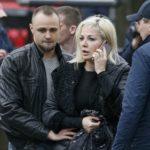 Maria Maksakova, widow of former lawmaker of the Russian State Duma Denis Voronenkov, speaks on her phone at the scene of the murder of her husband in central Kiev, Ukraine, March 23, 2017.