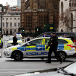Armed police respond outside Parliament during an attack on Westminster Bridge in London, March 22, 2017.