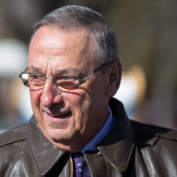 Governor Paul LePage attends a maple tree tapping ceremony on a cold day in mid-March. LePage now backs the American Health Care Act and is urging Maine's senators to support it.