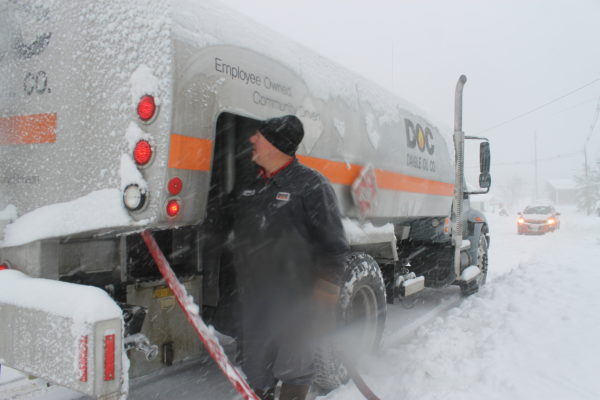 Mark Charette of Fort Kent, delivers home heating oil to a Fort Kent resident, Thursday, Dec. 1, during the season's first big snow event.