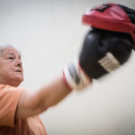 Sally Moulton, 67, of Harpswell punches trainer Andy Anderson's glove during a Rock Steady Boxing class in Brunswick which she attends with her husband John who has Parkinson's disease. Rock Steady Boxing is an exercise program adapted to people with the disease.