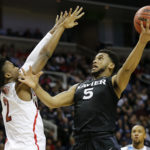 Xavier's Trevon Bluiett (5) scores against Arizona's Kobi Simmons in the first half during Thursday's West Regional semifinal in the 2017 NCAA tournament at SAP Center in San Jose, California.