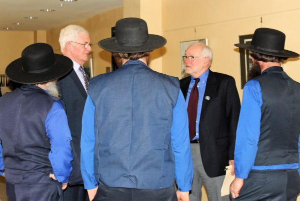 Rep. David McCrea, D-Fort Fairfield, (second from right) and Sen. Michael Carpenter, D-Houlton, welcome members of the Fort Fairfield/Easton Amish community to the State House on Thursday, March 16. The Amish attended a public hearing that day to testify in support of legislation to allow them to wear red instead of orange during hunting season. Their national church group opposes wearing hunter orange due to its bright color.