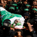 Palestinian members of Hamas' armed wing carry the body of senior militant Mazen Fuqaha during his funeral in Gaza City, March 25, 2017.