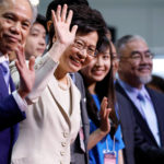 Carrie Lam waves during news conference after she won the election for Hong Kong's Chief Executive in Hong Kong, March 26, 2017.