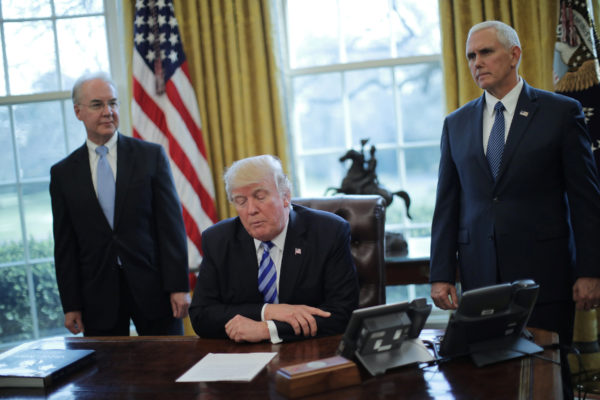 President Donald Trump talks to journalists at the Oval Office of the White House after the health care bill was pulled before a vote, accompanied by U.S. Health and Human Services Secretary Tom Price (L) and Vice President Mike Pence, in Washington, March 24, 2017.