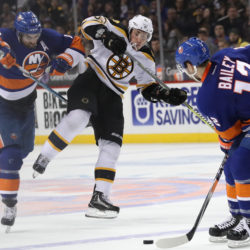 Andrew Ladd (16) of the New York Islanders controls the puck against Boston's Brad Marchand (63) during the third period of Saturday's game at Barclays Center. The Bruins won 2-1.