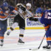 Bruins top Islanders, move ahead in wild-card race
