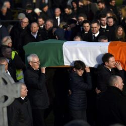 The coffin of Martin McGuinness is carried through crowded streets during his funeral in Londonderry, Northern Ireland, March 23, 2017.
