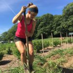 Lilly Kuhn of Yarmouth harvests potatoes during Wolfe's Neck Farm's summer Teen Agriculture program in Freeport.