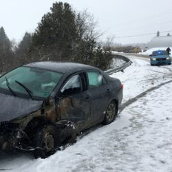 Monday's snowy roads apparently caused a New Brunswick woman's vehicle to crash into a log truck on Corner Road in Bridgewater.