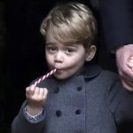 Prince George, the son of the Duke and Duchess of Cambridge, leaves following the morning Christmas Day service at St. Mark's Church in Englefield, near Bucklebury in southern England, Britain, Dec. 25.