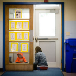 Student Quinn Coon works with a staff member, who asked not to be named, in a makeshift teaching space at Harrison Lyseth Elementary School in Portland. City government is considering funding renovations to Lyseth and other schools in the system.