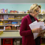 Wendy Harrington checks her paperwork at the Weald Bethel Food Pantry in Cherryfield on Dec. 20.