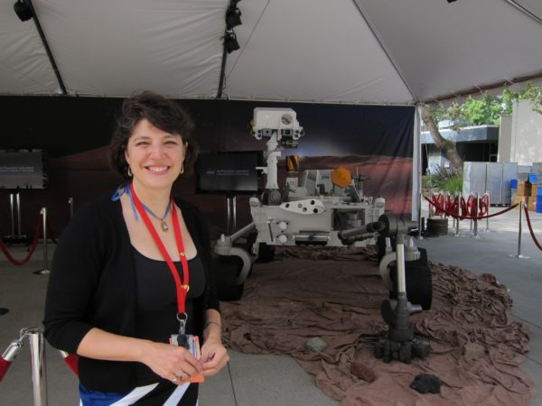 Dr. R. Aileen Yingst in front of a mock Curiosity rover. Yingst, a Brunswick, Maine resident who works as a scientist on the Curiosity mission with the Planetary Science Institute, has been helping fellow researchers on the Curiosity project come up with Maine place names to give to surface features and locales the rover encounters on Mars.