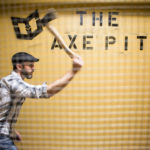 WESTBROOK, MAINE -- 03/28/17 -- Tim Johnson lets one fly behind a metal screen in The Axe Pit at Maine Warrior Gym in Westbrook on Tuesday. Johnson, who co-owns the gym, said ax throwing is more about stress release that fitness. Troy R. Bennett | BDN