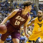Nick Mayo of Belgrade (left) is pictured playing for Eastern Kentucky in December 2015. He is among only a handful of Maine players who have been able to earn a spot on a Division I college basketball roster in recent years.