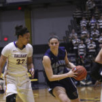 The University at Albany's Tiana-Jo Carter (left) is pictured playing against the University of Maine during the 2017 America East championship game at SEFCU Arena in Albany, New York. Carter, who lives in Naples, has made a successful transition to Division I basketball.