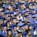 Members of the Class of 2016 at the University of Maine await their degrees at their graduation at Alfond Arena at the Orono campus last spring. The University of Maine System is expected to approve in May the first system-wide tuition increase in the past six years.