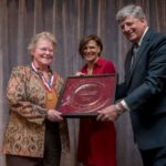 Cheryl Lee Rust, left, receives a lifetime achievement award from Maine Restaurant Association board chair Michelle Corry, and president Steve Hewins Tuesday night at a gala celebration.