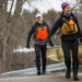 Eric Gallandt, president of the Maine Canoe and Kayak Racing Organization, carries an old racing canoe down to the Pushaw Stream in Old Town on Tuesday with canoe partner Nicole Grohoski.