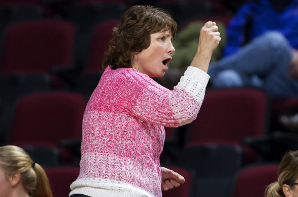Central head coach Diane Rollins cheers on her team during their basketball game against John Bapst at the Cross Insurance Center in Bangor.