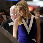Ivanka Trump touches a piece of moon rock at an exhibit at the Smithsonian