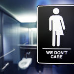 A sign protesting a recent North Carolina law restricting transgender bathroom access adorns the bathroom stalls at the 21C Museum Hotel in Durham, North Carolina, May 3, 2016.
