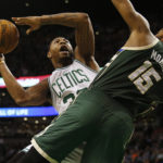 Boston's Marcus Smart (left) battles Milwaukee's Greg Monroe under the basket during the second half of Wednesday's NBA game at TD Garden in Boston. The Bucks won 103-100.