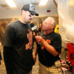 Baltimore Orioles catcher Matt Wieters (32) is interviewed by Gary Thorne as the Baltimore Orioles celebrate with champagne after beating the New York Yankees 5-2 to clinch an American League Wild Card playoff spot at Yankee Stadium on October 2016.