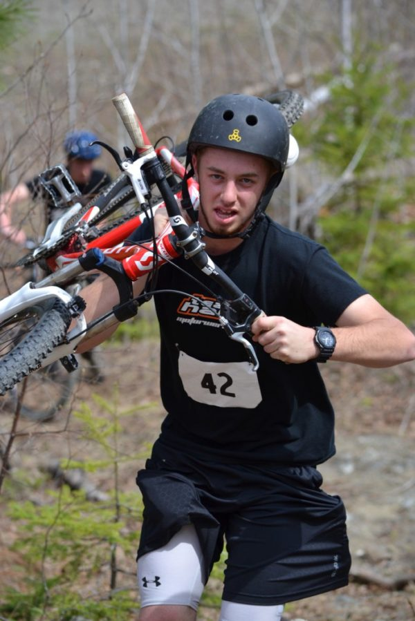 Ben Humphrey of Pownal carries his mountain bike during the 2016 East Grand Adventure Race in Danforth.