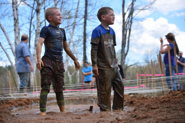 Philip Espenscheid (left), 7, of Brookton, and Cooper Scott, 8, of Merrill, complete together in the mud crawling challenge during the 2016 East Grand Adventure Race in Danforth. Their participation in the race spurred the creation of the new family-mentoring division, a condensed version of the race includes the compass run and paddling only legs, leaving out the biking leg.