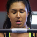 Jade Socoby takes a moment to regain composer before doing a squat workout at Union Street Athletics in Bangor Thursday. Socoby used powerlifting to lose over 130 pounds.