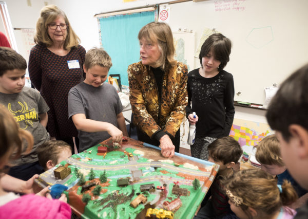 Cloe Chunn (center), a long-time Belfast Bay Watershed Coalition  volunteer, talks to 4th and 5th graders at the Kermit S. Nickerson School in Swanville Tuesday.