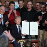 """U.S. President Donald Trump holds up an executive order on """"energy independence,"""" eliminating Obama-era climate change regulations, during a signing ceremony at the Environmental Protection Agency (EPA) headquarters in Washington, U.S., March 28, 2017. REUTERS/Carlos Barria          TPX IMAGES OF THE DAY"""