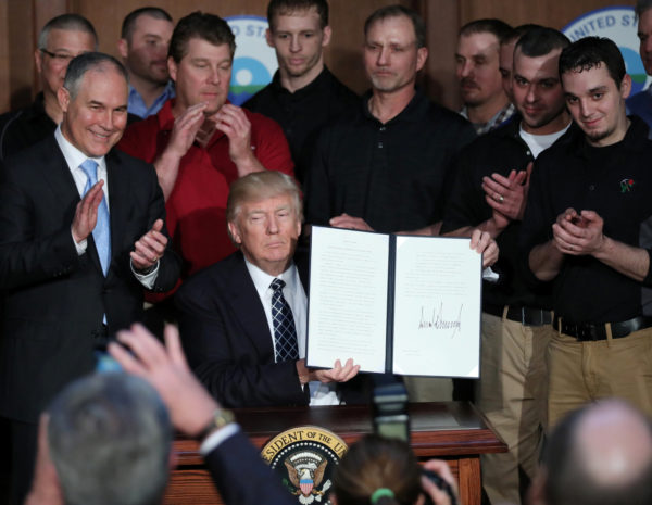 U.S. President Donald Trump holds up an executive order on &quotenergy independence,&quot eliminating Obama-era climate change regulations, during a signing ceremony at the Environmental Protection Agency (EPA) headquarters in Washington, U.S., March 28, 2017. REUTERS/Carlos Barria          TPX IMAGES OF THE DAY