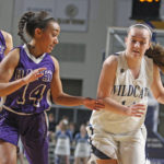 Emily Wheaton (right) of Presque Isle, pictured during a game in 2017, is among 15 honorees on the BDN All-Maine Schoolgirl Basketball Team.