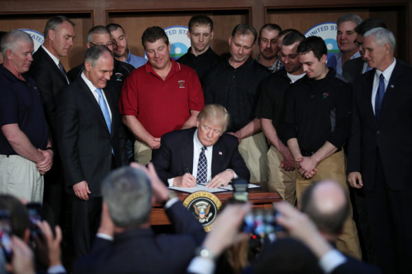 U.S. President Donald Trump signs an executive order on &quotenergy independence,&quot eliminating Obama-era climate change regulations, during an event at the Environmental Protection Agency (EPA) headquarters.