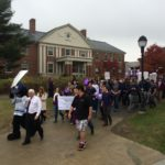 University of Maine students and officials participate in a 2014 domestic violence prevention walk on campus. A group of students want to reinstate the Women's Resource Center on campus, which closed in 2015 after 23 years of providing information on issues such as women's health and support for victims of domestic violence.