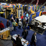 Visitors walk through a large variety of displays from vendors at the 47th Annual Bangor Home Show at the Cross Center on Friday afternoon.