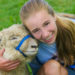 "Cassidy Charette with her ""adopted"" sheep, Erwin, at Hart-to-Hart Farm Camp in 2012. The Albion Farm will host its first ShineOnCass Easter Egg Hunt, free to the community  April 9, 2 to 4 pm. Families are asked to bring pet items to be donated to the Waterville Area Humane Society in Cassidy's honor."