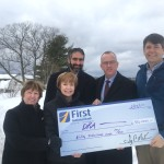 First National Bank presents Damariscotta River Association with a check at DRA Round Top Farm in support of DRA's capital campaign to enhance education programs, conserve special lands, and protect water quality. Pictured from the left are Emily MacKenzie, DRA Leadership Gifts Chair and former Board President, Susan Norton, First National Bank Executive Vice President and Chief Administrative Officer, Gary Stone, First Advisors Vice President and Portfolio Manager, Tony McKim, First National Bank President and CEO, and Steven Hufnagel, DRA Executive Director.